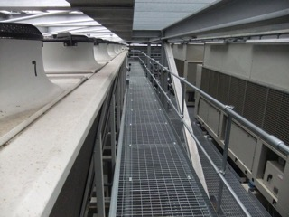 Walkway with standard open mesh floor grating